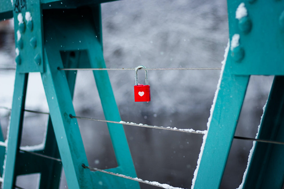 heart padlock on bridge - locking in customers customer retention