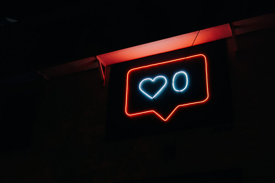 neon signage outline of instagram likes
